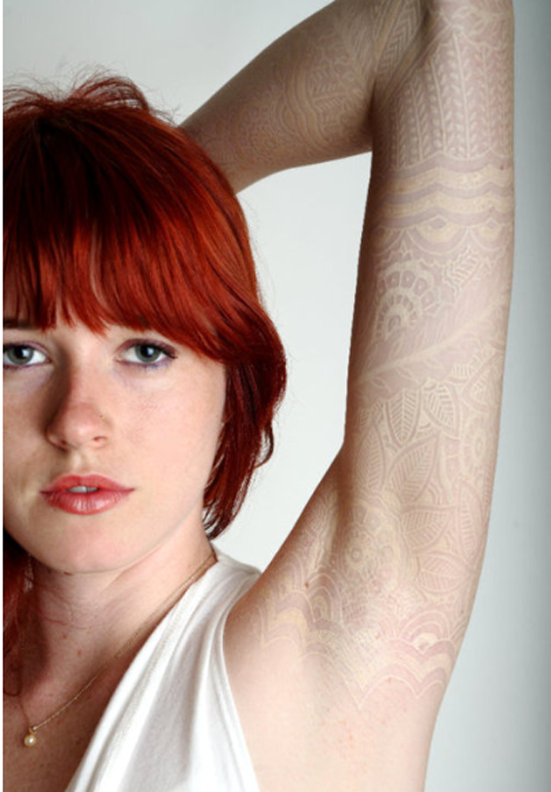 A white lace tattoo on pale skin creates the subtle illusion that this girl has lace beneath her skin large #tattoofriday   Lace Tattoo/Renda
